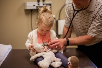 Photo of doctor with young patient